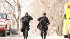 SWAT Paramedics walking towards camera Stock Footage