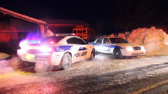 Modern looking police car on snow at night Stock Footage