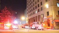 Firetrucks with lights in front of heritage building Stock Footage