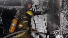 Fireman spraying water and forming ice sickles Stock Footage
