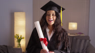 Stock Video Footage of Mexican woman happily wearing cap and gown