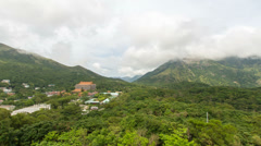 Time lapse of moving clouds over Po Lin Monastery in Ngong Ping in Hong Kong Stock Footage
