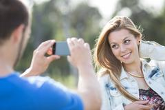 couple carrying a photo - stock photo