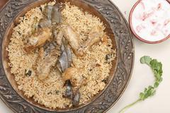 hyderabadi chicken or mutton based biryani - stock photo