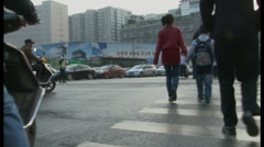 Crossing street, Xian China Stock Footage