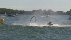 Flyboard competition on Toronto waterfront on hot sunny summer day Stock Footage