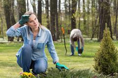 exhausting work in garden - stock photo