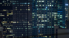 Windows of office buildings at night in downtown Los Angeles city. Timelapse. - stock footage