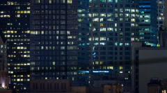 4K. Windows office buildings night downtown Los Angeles city. Pan up. Timelapse. Stock Footage