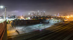 Downtown Los Angeles city at night with railroad tracks. Zoom in. Timelapse. Stock Footage
