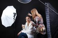 Stock Photo of make-up artist preparing female model for photo shoot