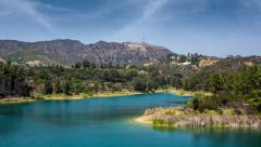 Lake Hollywood Reservoir with view on Hollywood Sign. Los Angeles, California Stock Footage