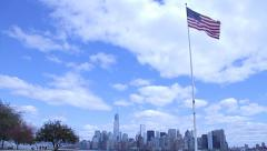 American Flag Pole with New York Skyline Backdrop Stock Footage