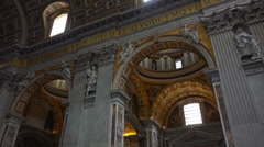 Italy, Rome, inside St. Peter's Cathedral, interuor, tourists, believers. Stock Footage