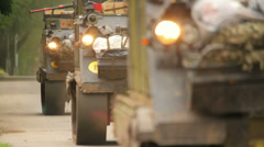 Armoured fighting vehicles drive along the road, close-up - stock footage