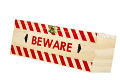 wooden box with brass clasp and word beware - stock photo