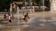 Stock Video Footage of Children Running Through The Fountain