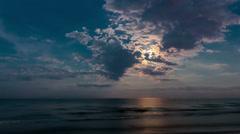 moon over ocean night timelapse cloudy sky - stock footage