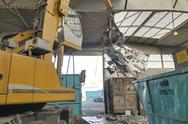 Stock Photo of Excavator in a scrap metal recycling plant