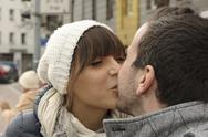 Stock Photo of Portrait of kissing young couple in winter