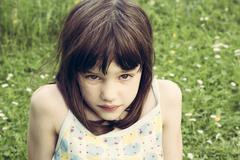 Portrait of little girl pouting mouth Stock Photos