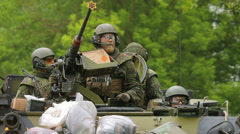 Soldiers looking around in an armoured fighting vehicle Stock Footage