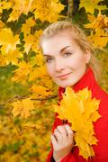 Beautiful young woman in atumn forest Stock Photos