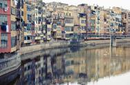 Stock Photo of Spain, Catalonia, Girona Province, View on the Onyar river and the row of houses