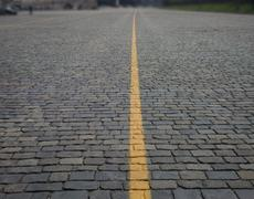 brick road to blur - stock photo