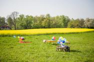 Stock Photo of Wooden trolley with balloons and table of children's birthday party on a meadow