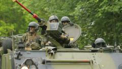Soldiers drive and looking around in an armoured fighting vehicle Stock Footage