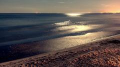 Ocean night timelapse city lights horizon over water Stock Footage