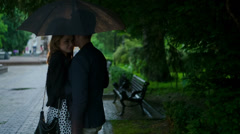 Couple in love kissing under the rain Stock Footage