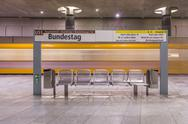Stock Photo of Germany, Berlin, modern architecture of  subway station Bundestag with moving
