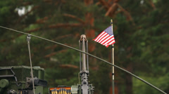 US flag above an infantry vehicle near the forest, close-up - stock footage