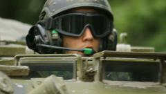 Soldiers drive in infantry vehicles, portrait, pass by Stock Footage