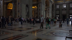 Italy, Rome, inside St. Peter's Cathedral, interuor, tourists, believers. - stock footage