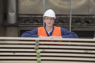 Stock Photo of Young worker at carpentry of pallet production