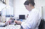 Stock Photo of Portrait of female food analyst working in laboratory