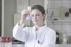 Portrait of female food analyst working in laboratory Stock Photos