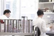 Stock Photo of Two food analysts working in laboratory