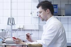 Stock Photo of Portrait of food analyst working in laboratory