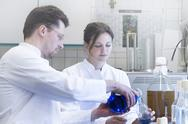 Stock Photo of Two food analysts working together in laboratory