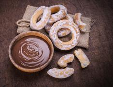 Chocolate cream and bagels on dark wood background Stock Photos