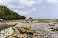 Stock Photo of Indonesia, Riau Islands, Bintan, Nikoi Island, Beach with granite blocks