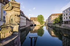 Germany, Bavaria, Nuremberg, view to Heilig-Geist-Spital at Pegnitz River - stock photo