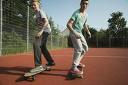 Stock Photo of Two boys on skateboards