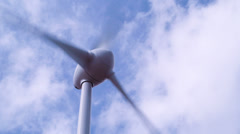 Electricity generating wind turbine, blue sky and clouds, summer day closeup, 4k Stock Footage