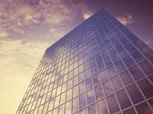 Stock Illustration of Glass facade with reflections of clouds, 3D Rendering