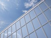 Stock Illustration of Part of glass facade with reflection of cloud, 3D Rendering